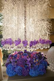 purple and blue flowers whimsical garden themed wedding concept in shades of purple