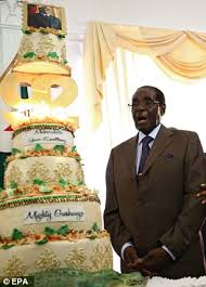 robert mugabe is given 92nd birthday cake as he is compared to