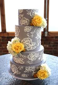 picture of grey wedding cake with lacy flowers and yellow roses