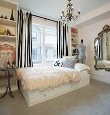 bedroom bedroom storage ideas with swing arm lamp and tufted bed