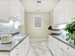 White Cabinets For Laundry Room Laundry Room With Table Island And White Cabinets Cleaning Tips