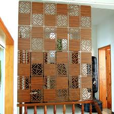 this hanging room divider is from carved wood panels and comes in
