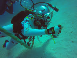 student designed spacewalk tools from training pool to ocean
