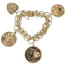 cartier bracelet charm images 1950s gold multi charm bracelet with cartier charm at 1stdibs jpg