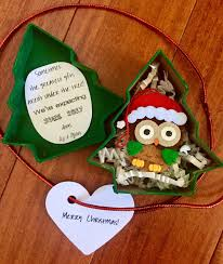 christmas pregnancy announcement ornament in tree gift box