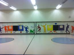 easy wall mural in gym using p e standard words brightens up and