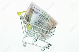 indian cart indian rupees in shopping cart over white background stock photo