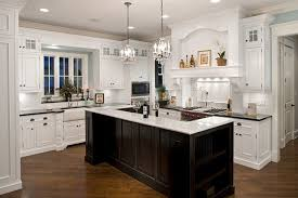 white kitchen cabinets with black island oakley home builders
