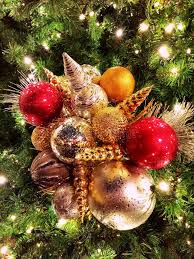 beaded ornaments clustered on outdoor tree stock