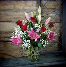 roses and lilies roses and lilies available for local st cloud area delivery in