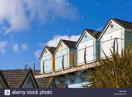 beach huts at alum chine bournemouth in march stock photo