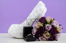 bridal shoes and dried flowers in vase on white table top stock