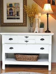 White Foyer Table Chic Foyer Features A Pair Of Seagrass Baskets Tucked Under A