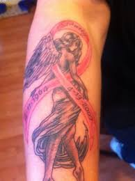memorable breast cancer ribbon and angel tattoos on arm