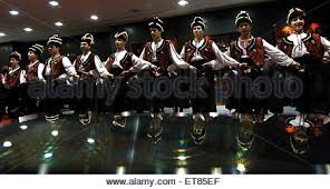 bulgarian carol singers perform a traditional christmas dance as
