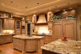 large country kitchen with curved wall and two islands cabinets