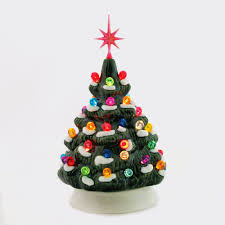 christmas tree with snow small ceramic christmas tree with snow electric lighted 6 inches