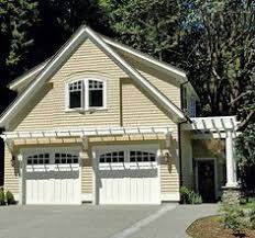 i really like the look of this garage with the doors u0026 big shed
