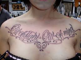 chicano lettering tattoo on chest photos pictures and sketches