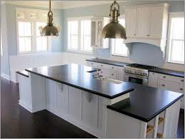 granite countertop dark kitchen cabinets with light island sea