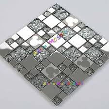 silver glass mosaic tiles mickey mouse mirror kitchen backsplash