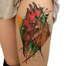 colorful rooster tattoo on left thigh