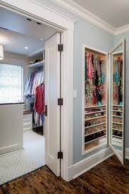 between the studs gun cabinet mirrored jewelry armoire in closet traditional with waypoint