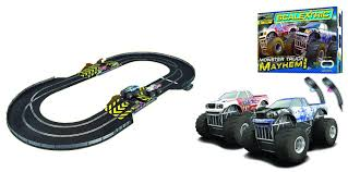 toy monster trucks racing scalextric 1 32 scale monster truck mayhem race set amazon co uk