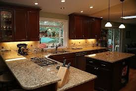 what color cabinets go with venetian gold granite giallo napoli granite cabinets backsplash ideas