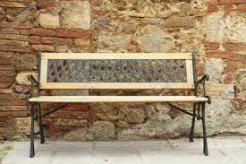 retro metal and wood bench in front of tuscan house italy europe