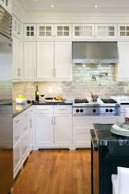 white kitchen cabinets with glass doors on top backsplash home kitchens contemporary kitchen kitchen design