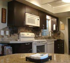 brown kitchen cabinets to white preciousinstants brown painted kitchen cabinets with white