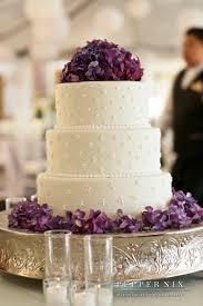 purple flowers on three layer cake wedding ideas pinterest
