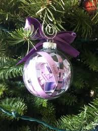 clear ornament with newborn hat and hospital bracelet baby