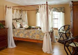 Four Poster Bed Curtains Drapes Bedroom Design Bedroom With Cork Flooring And Wooden Armchairs