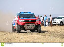 toyota rally car speeding red and blue toyota hilux twin cab rally car front view