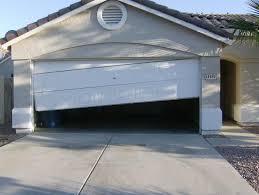 Garag by Garage Door Off Tracks In Greensboro