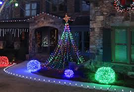 outdoor christmas yard decorating ideas make a diy christmas light tree for the yard using string lights and a basketball pole