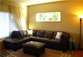 yellow living room walls large living room with black leather
