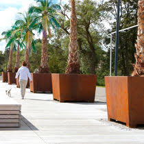 cor ten steel planter round contemporary for public spaces