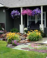front yard landscaping makeover with waterfall and adirondack