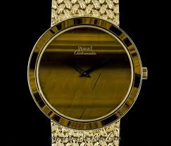 piaget automatic piaget 18k yellow gold tigers eye and bezel automatic gents
