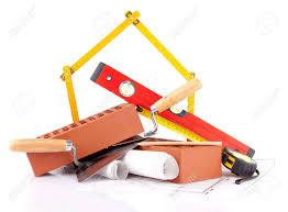house construction plans mason tools bricks and house construction plans stock photo