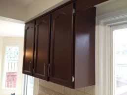 stained mahogany kitchen cabinet with storage and