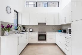 grey and white kitchen cabinet white tile floor in kitchen white floor tile black and
