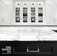 white kitchen black island kitchen with glass display cabinets transitional kitchen the