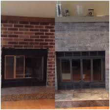 dyi fireplace make over i paint washed the brick with a light gray spray