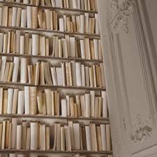 bookshelf wallpaper gives an instant library feel wallpaper that