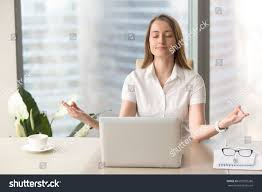 desk exercises at the office mindful businesswoman practices breathing exercises workplace