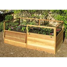 small inspiring wood raised bed vegetable garden along low fence